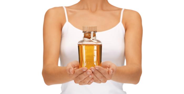 Olijfolie massage voor grotere borsten